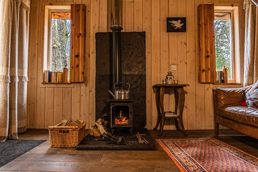 The Duck's Nest eco lodge, fireplace, Nethy Bridge, Near Aviemore, Cairngorms National Park, Scotland